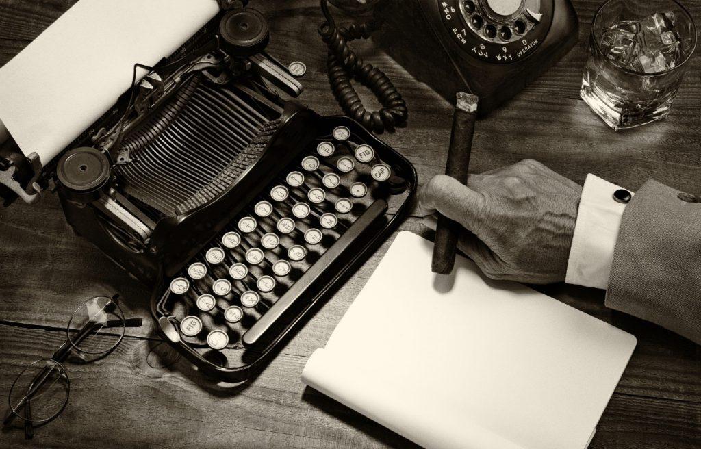 vintage typewriter with cigar smoker
