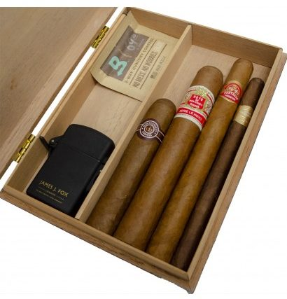 Some cigars in a gift humidor with a James J. Fox jet lighter and bodeva